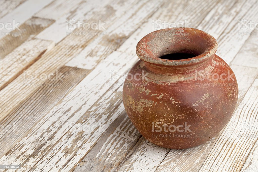 red clay pot on rustic table royalty-free stock photo