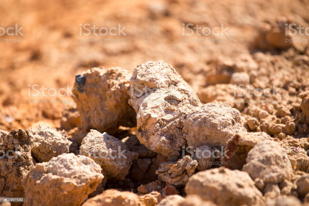 Red clay soil on nature as a background stock photo