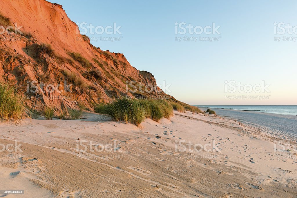 Red cliff on Sylt in Germany. Sunset stock photo
