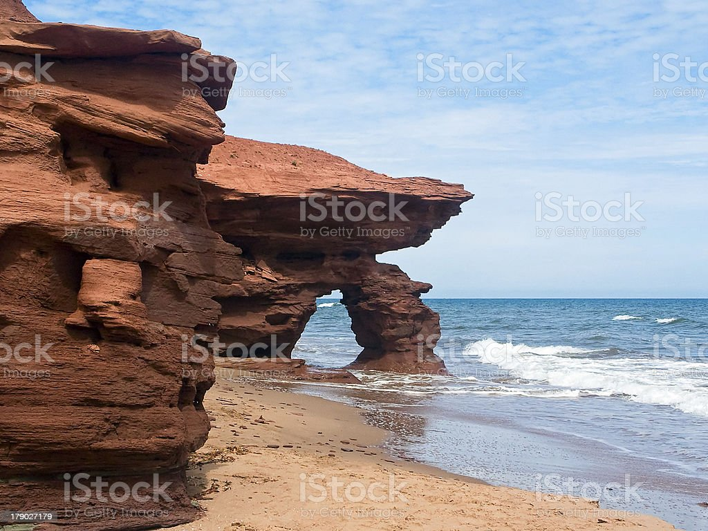 Red Cliffs and Arch on PEI Coast royalty-free stock photo