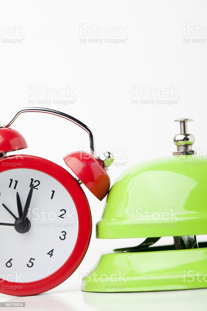 Red clock and green bell. royalty-free stock photo