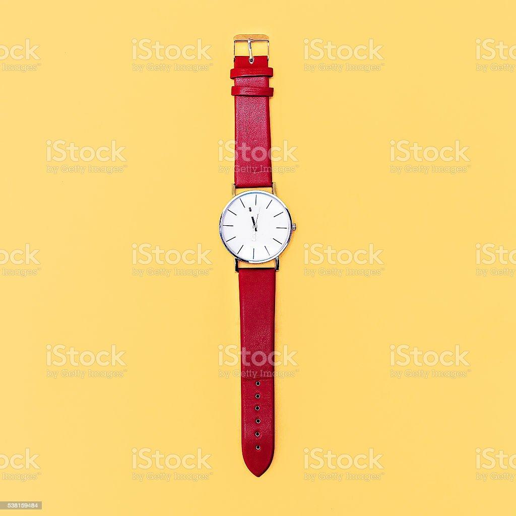 Red clock on yellow background. Minimalism design stock photo