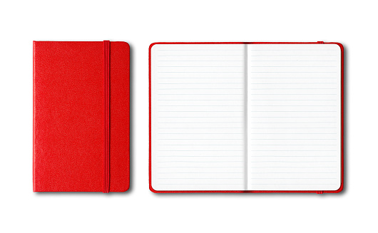 Red closed and open lined notebooks isolated on white