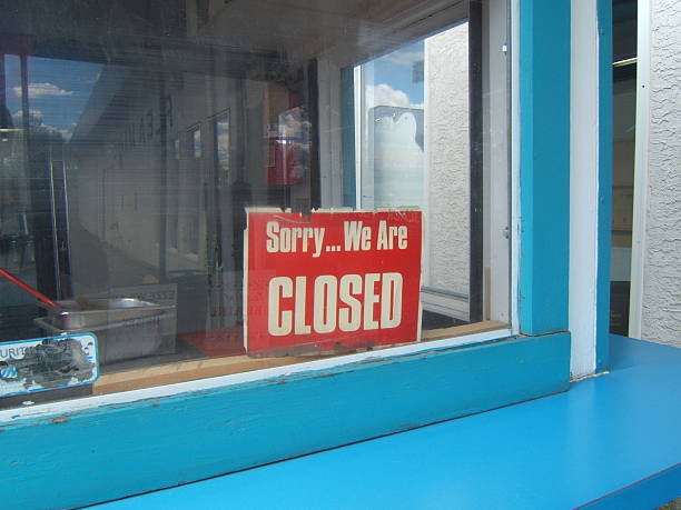 a red closed sign in the window of a blue building - closed stock photos and pictures