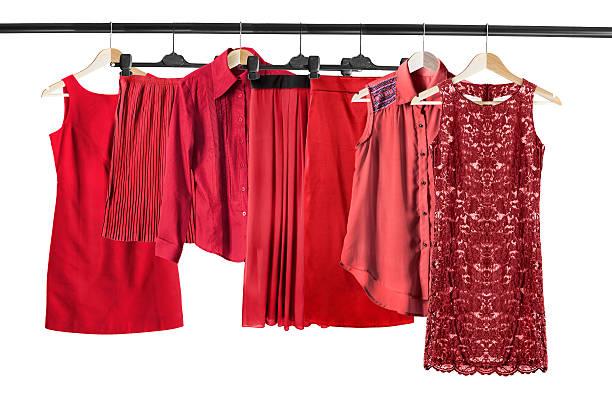 red clothes on clothes rack - damen rock kostüme stock-fotos und bilder