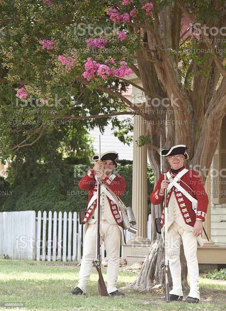 Red Coats Resting in Shade stock photo