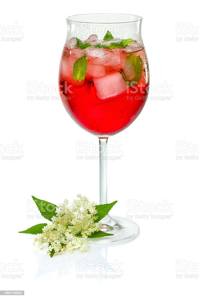 Red cocktail on white background with campari and mint stock photo