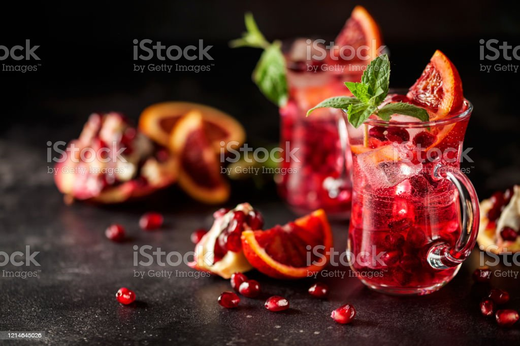 Red cocktail with blood orange and pomegranate. - Foto stock royalty-free di Agrume