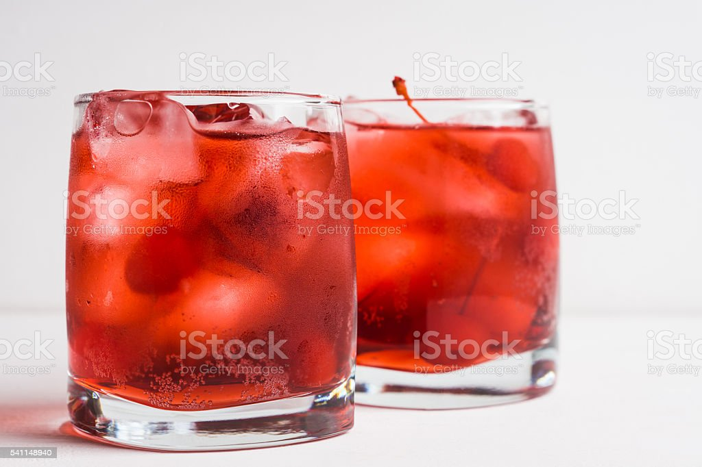 Red cocktail with cherry stock photo