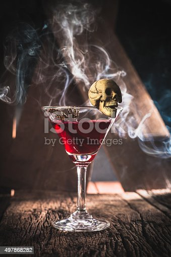 istock red cocktail with skull halloween party concept 497868282