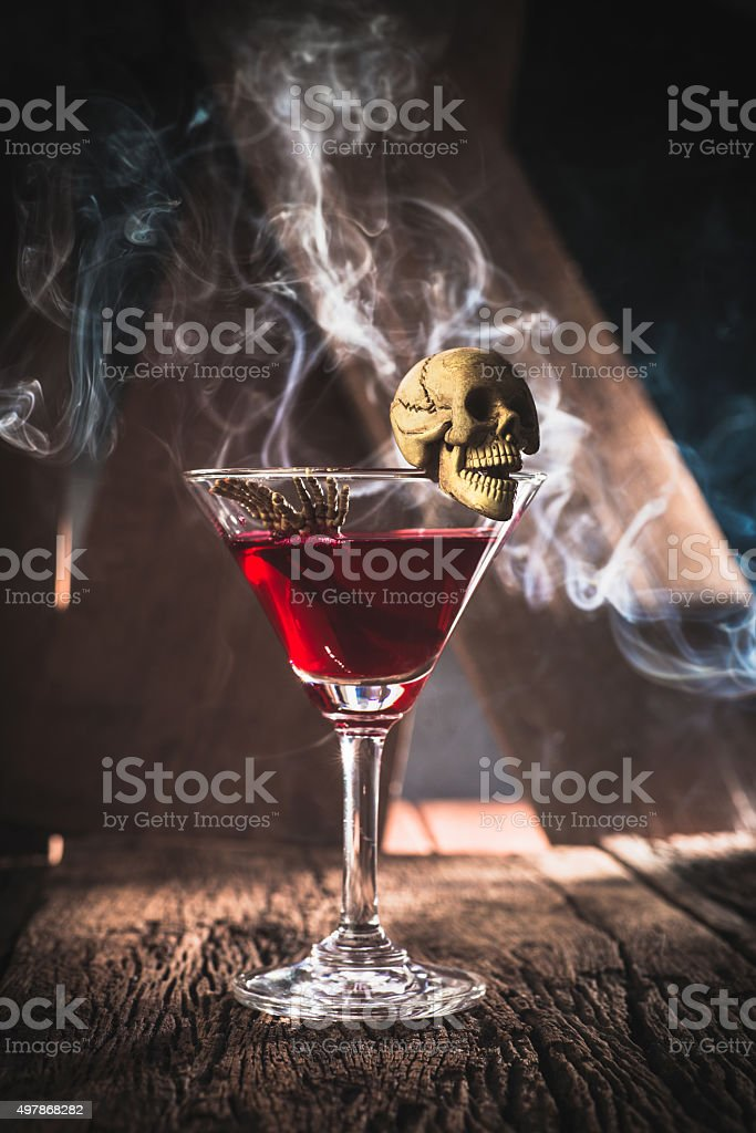 red cocktail with skull halloween party concept stock photo