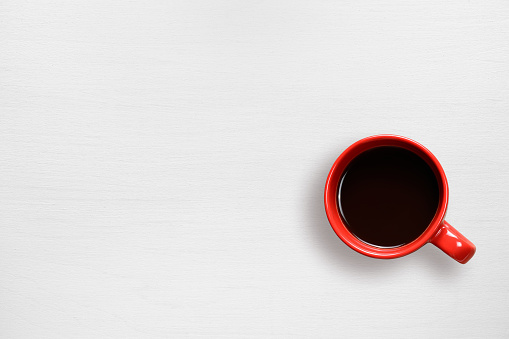 Red coffee cup on table