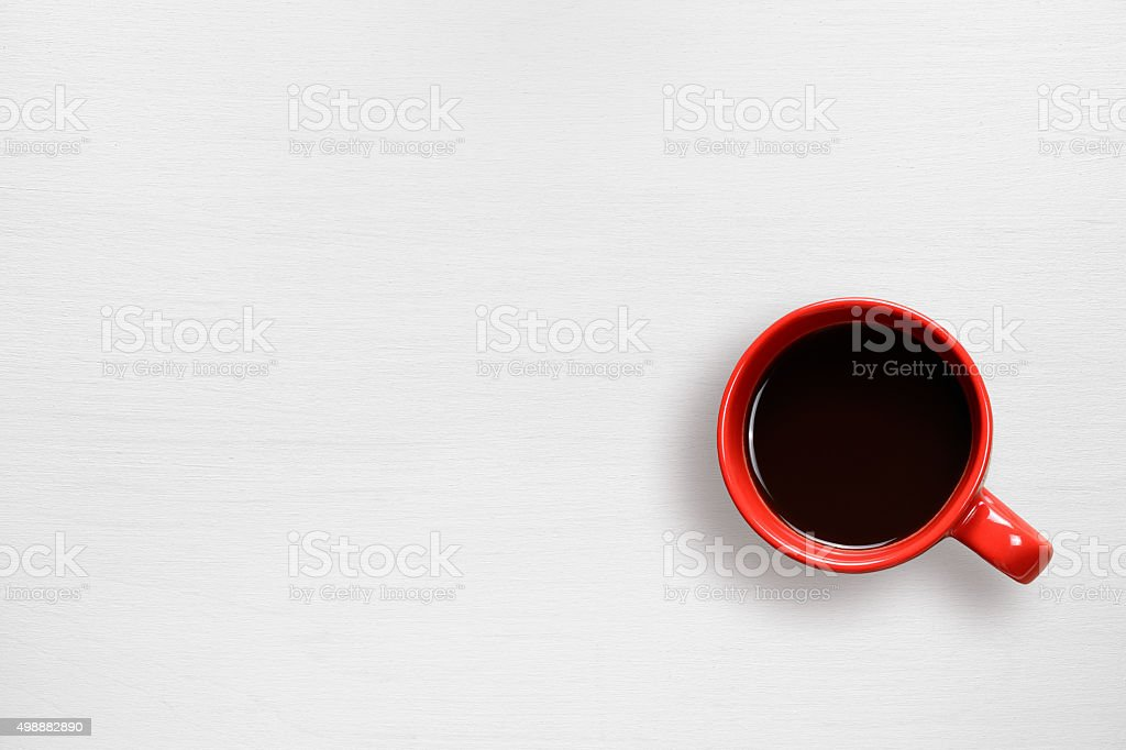 Red coffee cup on table stock photo