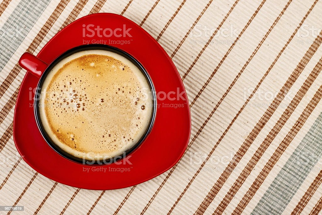 red coffee cup on tablecloth royalty-free stock photo