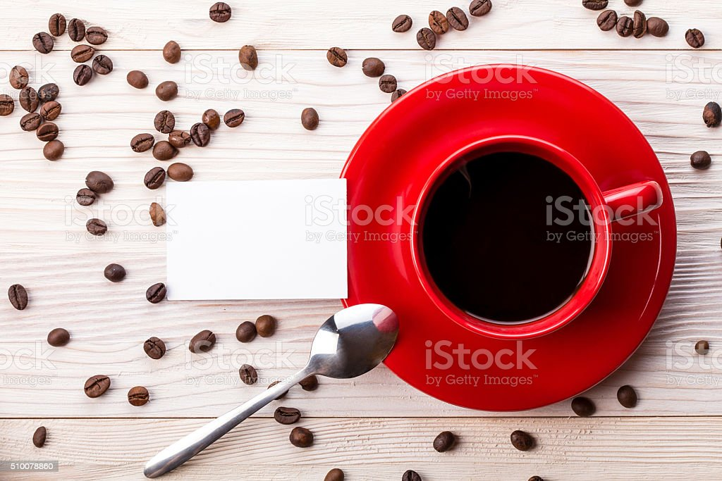 Red coffee cup with business card on table stock photo