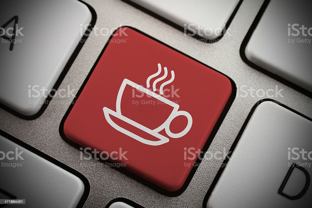 Red coffee icon key on a gray keyboard close-up stock photo