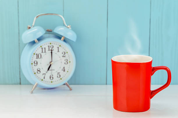 Red coffee mug on wooden table stock photo