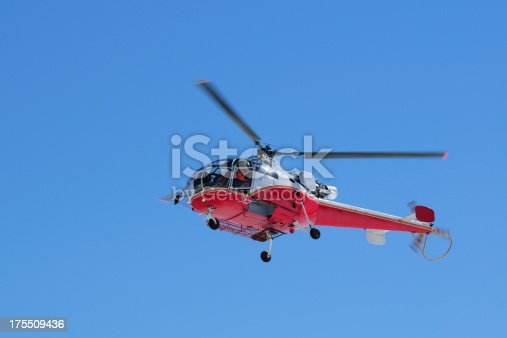 istock Red Color Helicopter with Blue Sky Background - XLarge 175509436