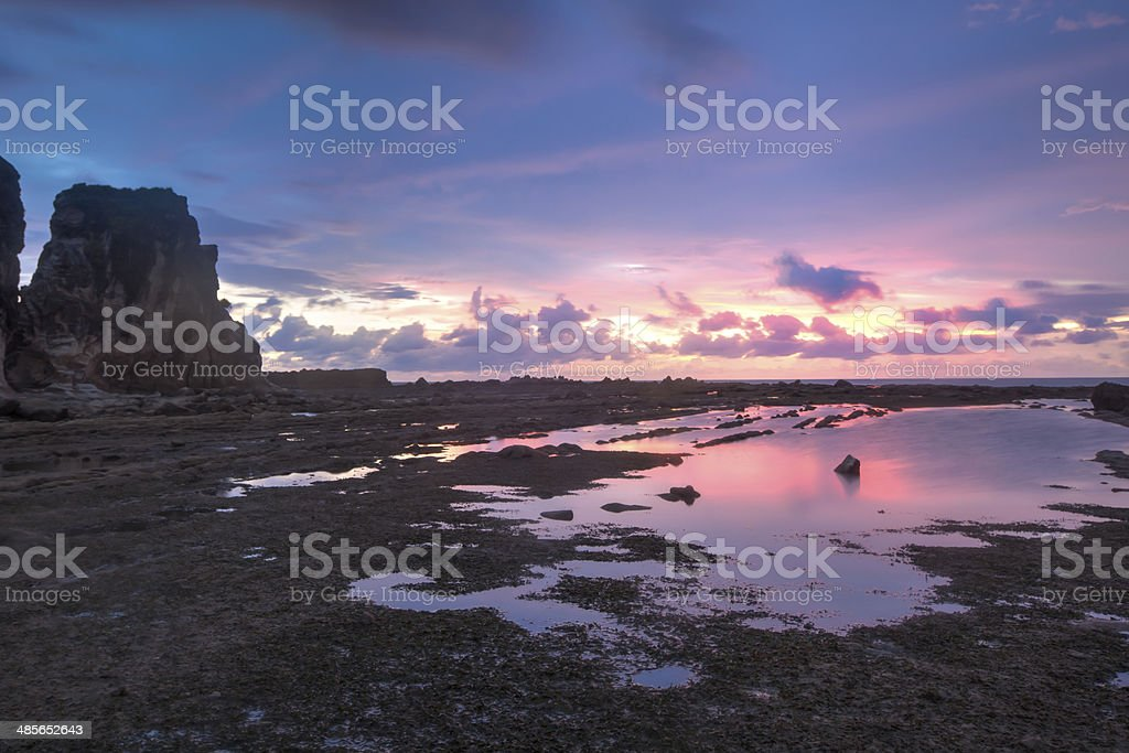 Red color of sunset at Sawarna beach Indonesia stock photo