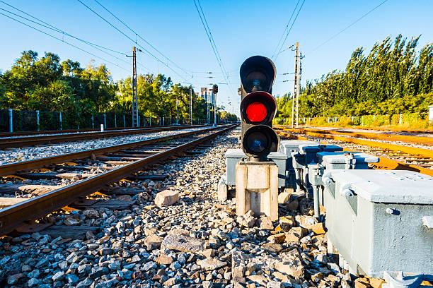 red color on the traffic light - railway signal stock photos and pictures