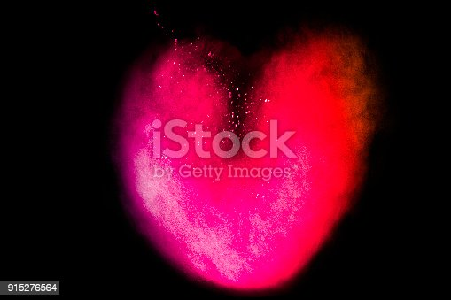 874001870 istock photo Red Color powder splash cloud isolated on black background 915276564
