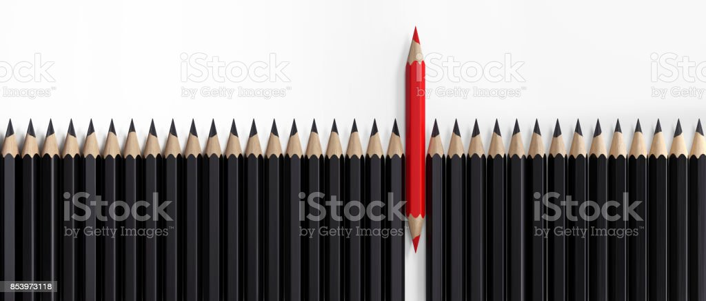 Red Colored Pencil Standing Out From The Crowd stock photo