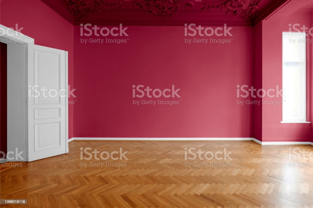 red colored walls in new painted room after renovation stock photo