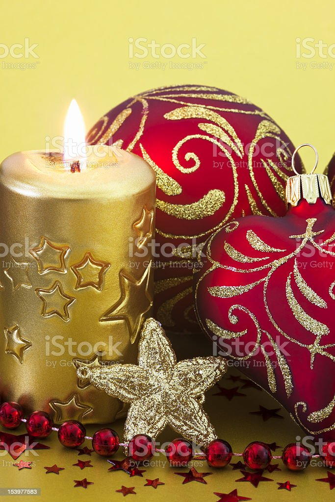 Red Coloured Christmas Baubles & Candle royalty-free stock photo