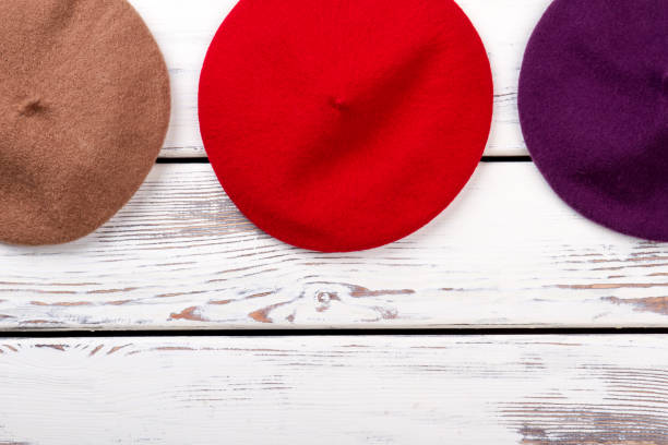 af5f06c2dc6 Red colourful berets top view. stock photo