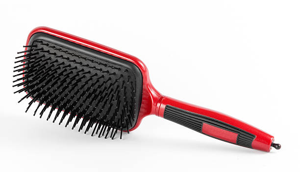 Red comb the hair on a white background stock photo