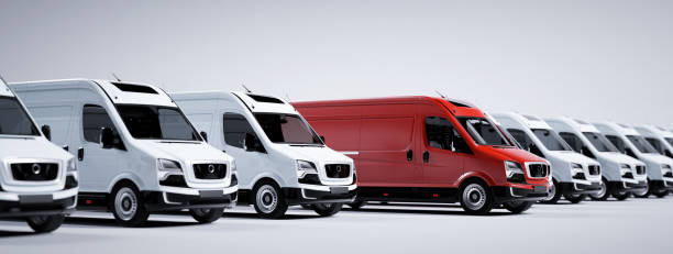 Red commercial van and fleet of white trucks. Transport. Transport and shipping stock photo