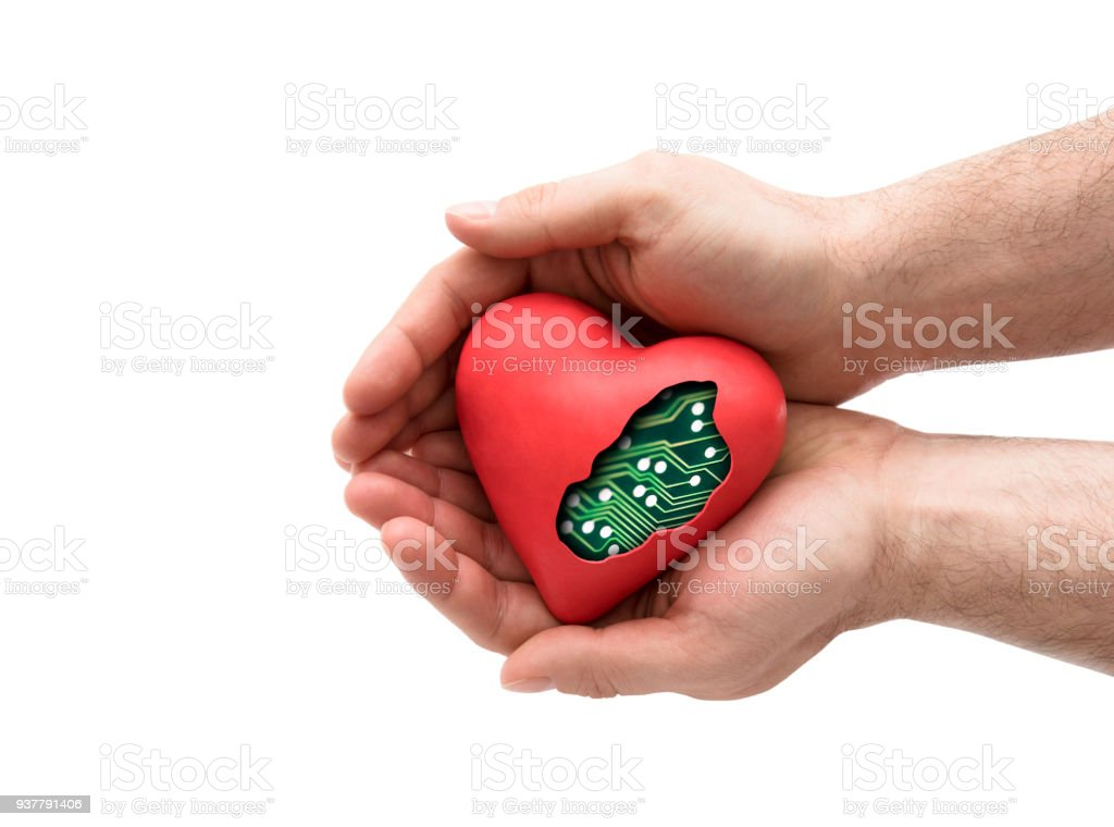 Red computer heart in hands isolated on white stock photo