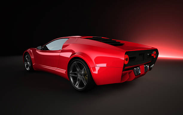 Red Concept car on dark background 3D Rendering image showing a concept design made by my own. This is the perfect stuff for people how need race cars, supersport cars without any manufacture brand. exoticism stock pictures, royalty-free photos & images