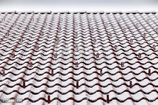 Perspective view at tile roof with snow