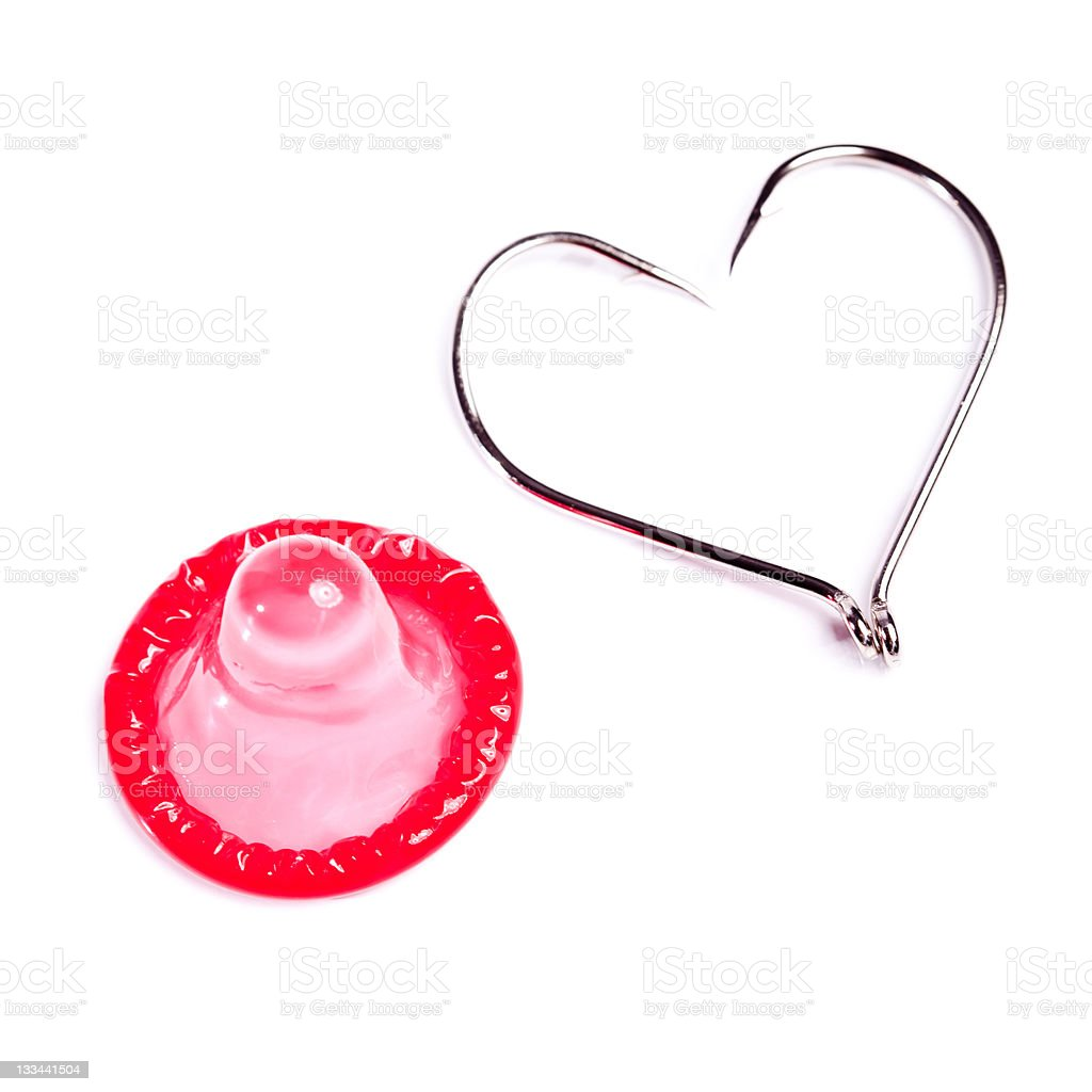 red condom and hooks creating a form of heart royalty-free stock photo