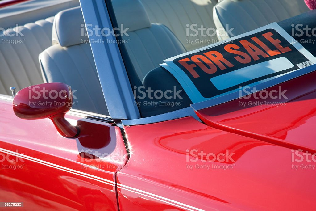Red convertible used car for sale stock photo
