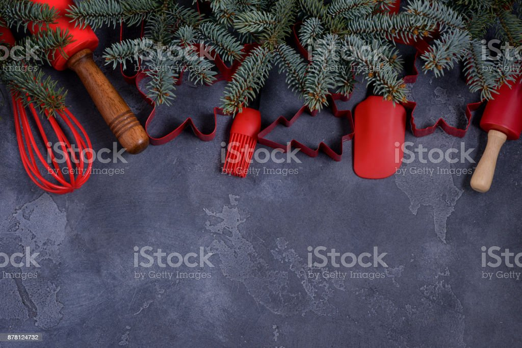 Red cookies cutters and utensils and fir tree stock photo