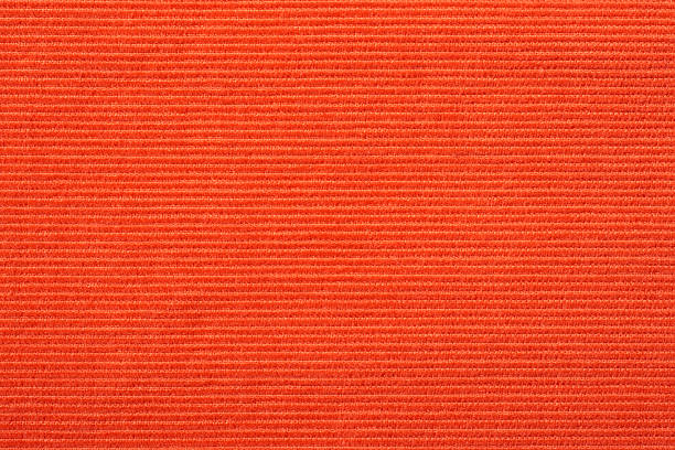 red corduroy texture - corduroy stock pictures, royalty-free photos & images