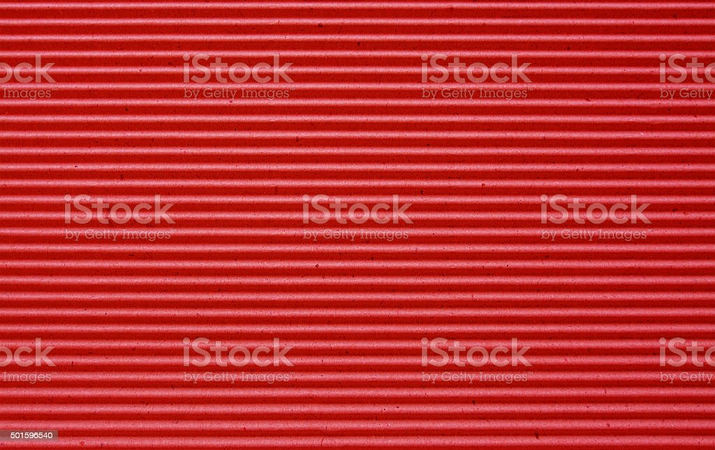 red corrugated paper background. stock photo