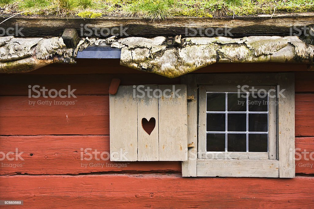 Red cottage with cork ceiling falling stock photo