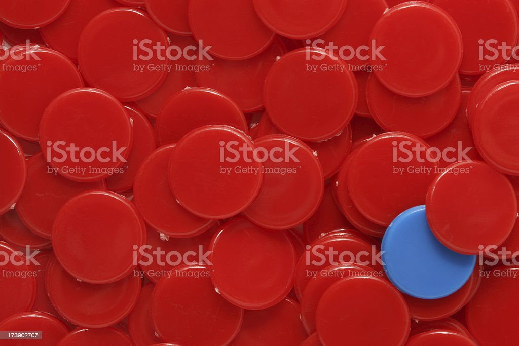 Red Counters with a Blue Minority stock photo