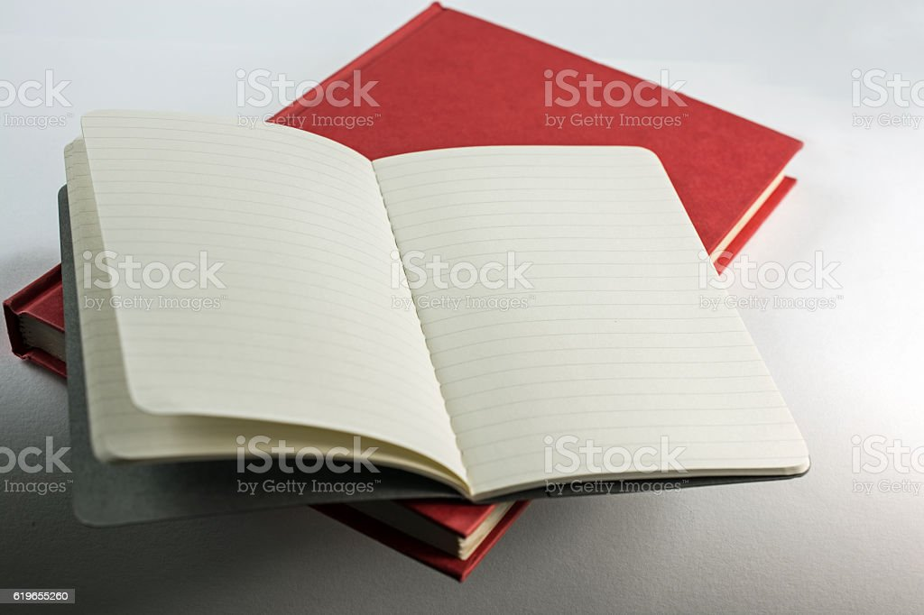 Red cover book with small open notebook ,copy space.