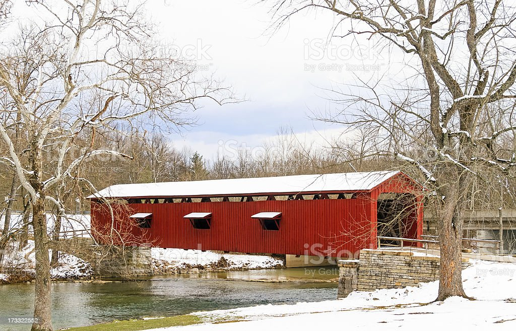 Red Covered Bridge and Snow stock photo