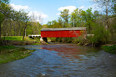 Red covered bridge in the Midwest on a beautiful Spring afternoon.