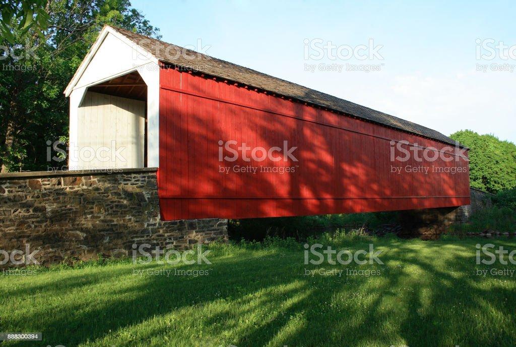 Red covered bridge stock photo