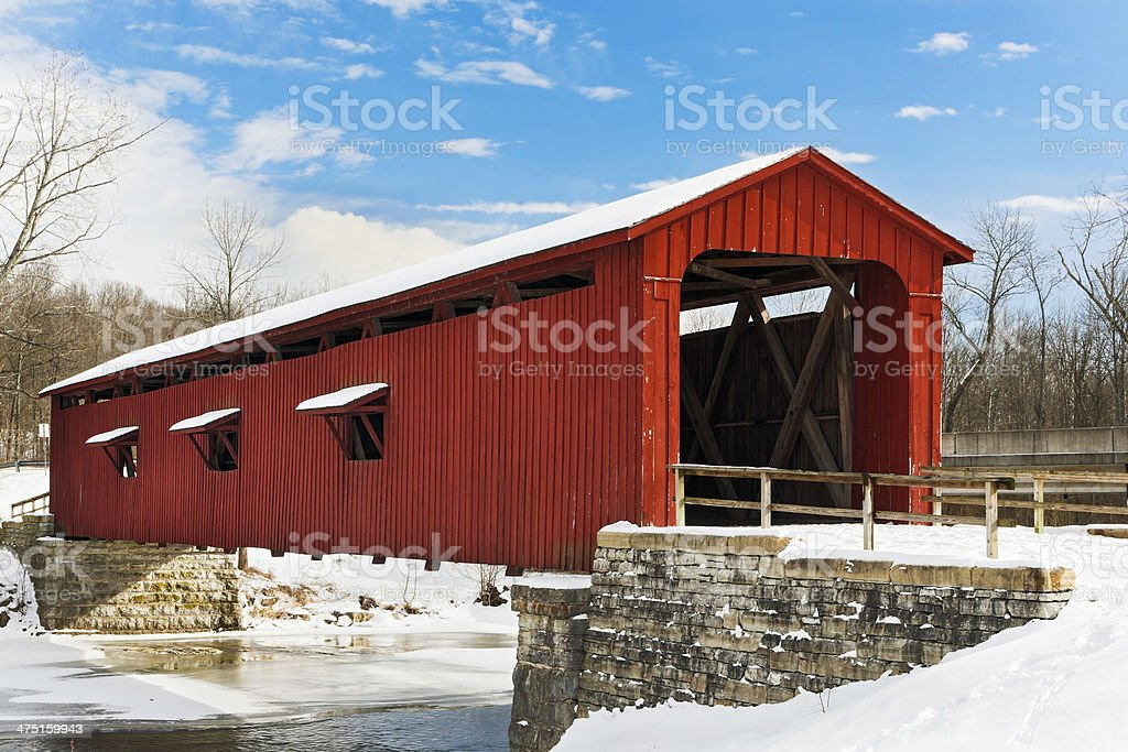 Red Covered Bridge with Snow stock photo