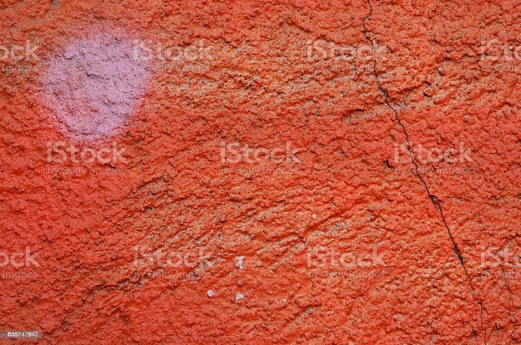 Red cracked wall stock photo
