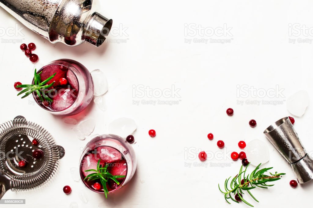 Red cranberry cocktail with ice, rosemary and vodka royalty-free stock photo