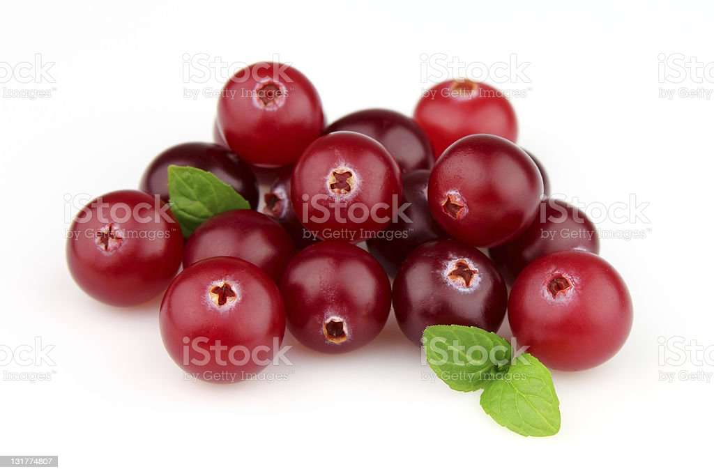 Red cranberry pile with green leaves on white background stock photo