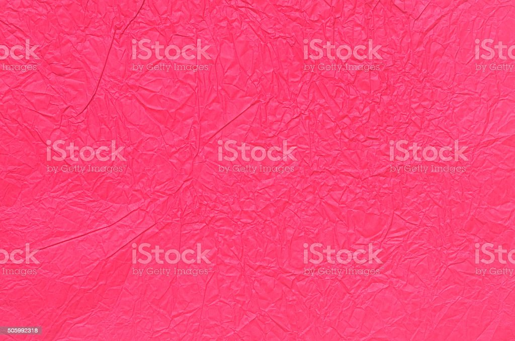 red creased tissue paper background stock photo